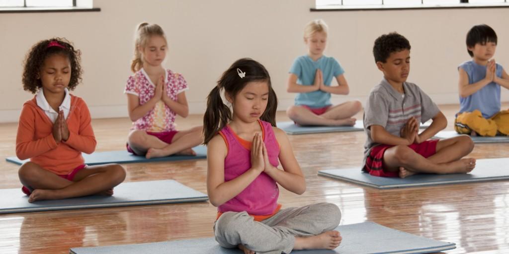 Children exercising in yoga class